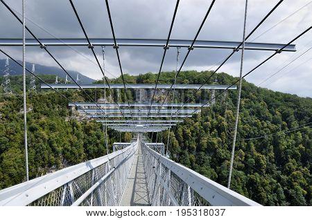 Russia Sochi Skypark - August 16 2014: The world's longest pedestrian suspension bridge in Aksterskim gorge Sochi