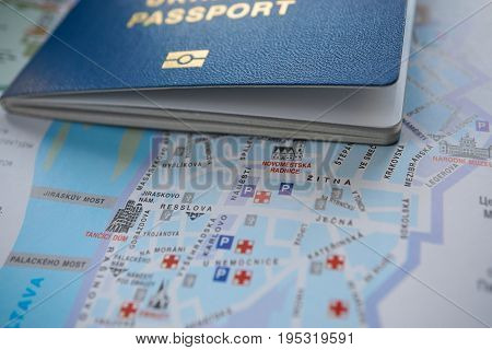 Foreign Passport And Tourist Route On Historical Center Of Prague