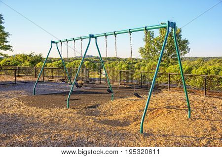 Empty chain swings in playground. Swing set at the park