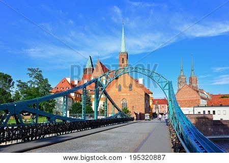 Tumski Bridge connecting old town and Sand Island of Wroclaw with Cathedral Island or Ostrow Tumski Poland.