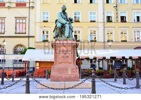 WROCLAW POLAND - JUNE 2017: Statue of the Polish poet playwright and comedy writer Aleksander Fredro in the Market Square in front of the Town Hall of Wroclaw - Poland.