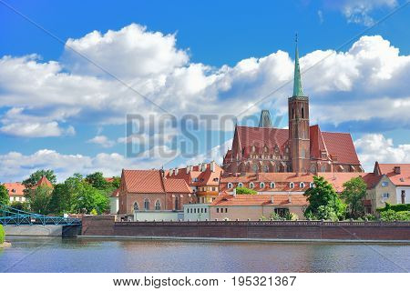 View on Church of the Holy Cross and St. Bartholomew Odra river and Tumski Island Wroclaw Poland.