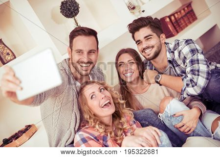 Friends together taking a selfie photo having a good time.