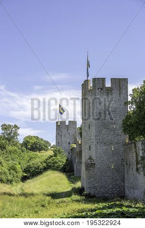 Town Wall in Visby Gotland with the Swedish flags.