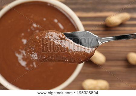 Shovel with creamy peanut butter, closeup