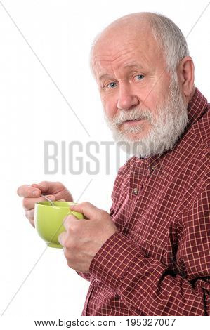 Cheerful and smiling handsome bald and bearded senior man with big green cup, isolated on white background