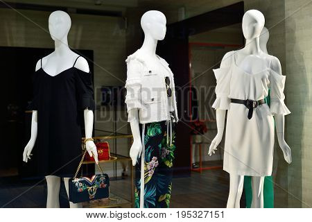 Showcase with a new collection of women's clothing. Italian fashion.