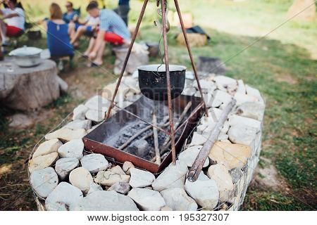 barbecue made of stone, on the background of people