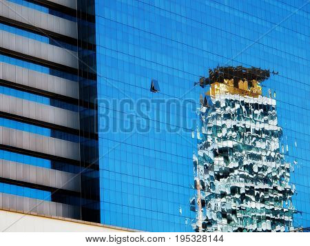 close up architectural detail from tall glass building in Thailand