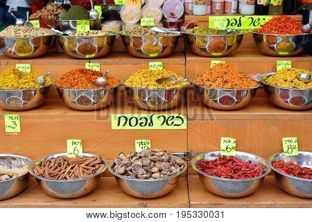 Spices at Mahane Yehuda market in Jerusalem. On tablets are written the prices for cinnamon pepper chili ginger mushrooms turmeric and various mixtures of spices for different meats