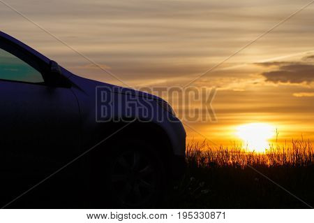 The Silhouette Of The Car At Sunset