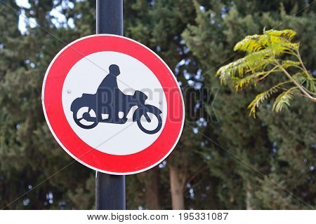 Motorcycle prohibition sign. Road sign before entering the park.