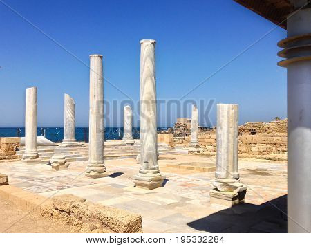 Roman old marbe column square in caesarea Archaeological site close to Herod the Great hippodrome