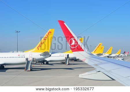 ISTANBUL TURKEY - APRIL 2017: Sabiha Gokcen airport. Airport jetway aerobridge skybridge. Airport air bridge. Pegasus and turkish airlines aircraft.
