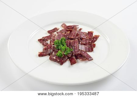 Jerky. Sujuk. Snack to beer. On white background menu concept.