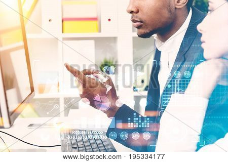 African American man and his beautiful colleague brainstorming in an office. Concept of business planning. Toned image double exposure