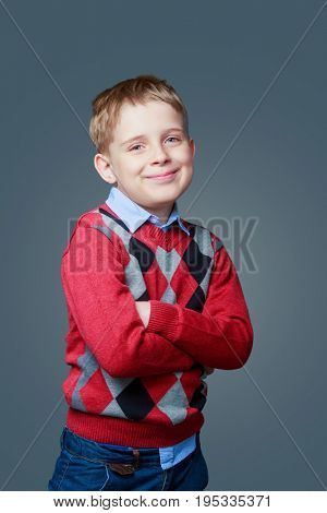 happy boy isolated against grey background