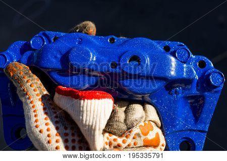 Blue 4 pot brake caliper un hand of car mechanic
