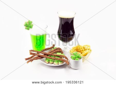 tall glass of dark beer and glass of stout bamboo green beer with tasty snacks Patrick's Day celebrations