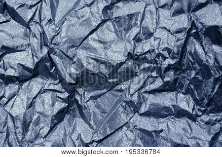 This full frame close up photograph of blue shiny metallic tissue paper offers a fantastic texture.