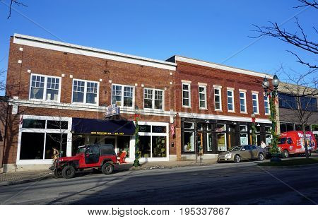 PETOSKEY, MICHIGAN / UNITED STATES - NOVEMBER 22, 2016: One may purchase furniture at Reid's Furniture Store, and cabinets from the Wolverine Cabinet Company, on Mitchell Street in downtown Petoskey.