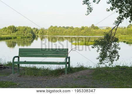 a quiet place with a bench at the river
