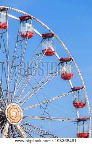 Ferris wheel on blue sky carousel in amusement park