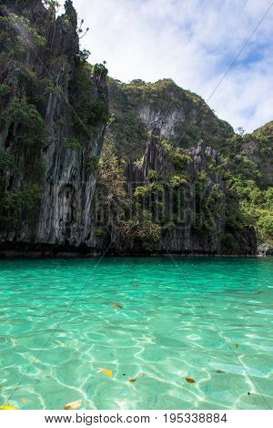 EL NIDO PALAWAN PHILIPPINES - JANUARY 17 2017: Green water and rocks in a sunny day of El Nido.
