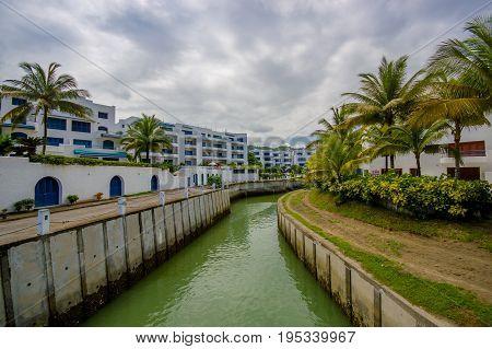 SAME, ECUADOR - MAY 06 2016: Small canal in downtown used for water circulation through the city at Same, Ecuador.