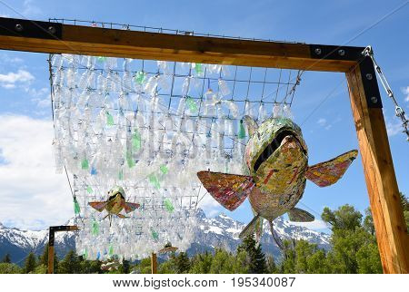 GRAND TETON NATIONAL PARK, Wyoming - JUNE 26, 2017: Art Installation at the Visitor Center. A plastic bottle river and aluminum can trout bring awareness to recycling in this student project.