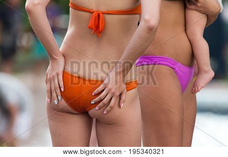 Pop girls in a swimsuit on the beach .