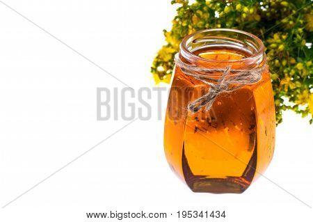 St. John's wort in glass jar on white background. Studio Photo