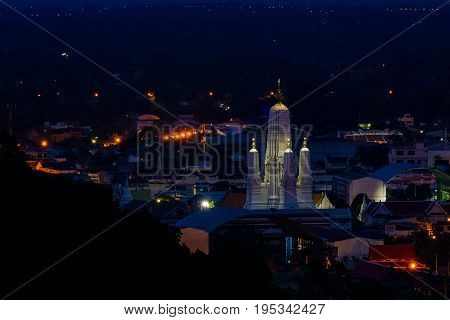 Wat Mahathat Worawihan From view point of view at Phetchaburi Province Thailand in twilight time.