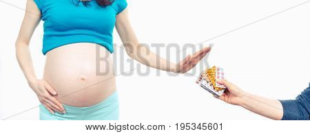 Woman In Pregnant Making Stop Gesture In Front Of Medical Tablets, Reduction Of Using Pharmaceutical
