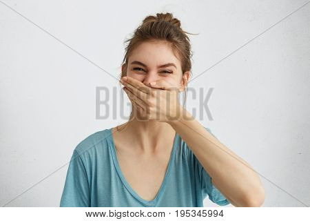 Positive Female Laughing While Having Good Mood During Spare Time Trying To Control Her Emotions Cov