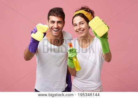 Housekeeping, Cleanliness, Hygiene And Domestic Work Concept. Happy Caucasian Young Family In Protec