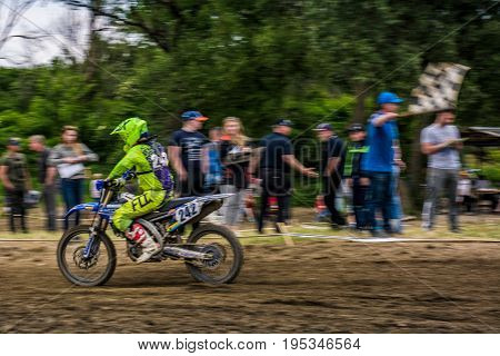 Mx Rider Finish The Race. Motion Blur With Flying Dirt