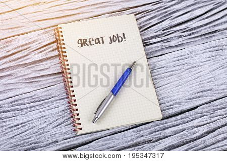 Great Job! word on a notepad .