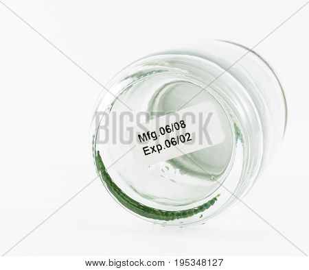 label expiration on glass bottle with with background