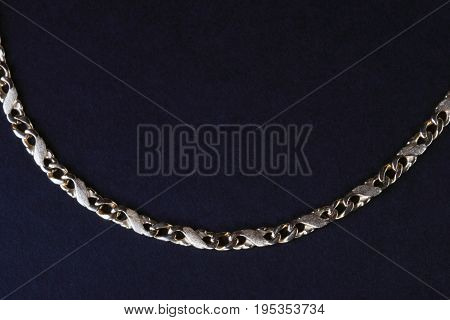 image of one yellow Gold Chain on black fabric