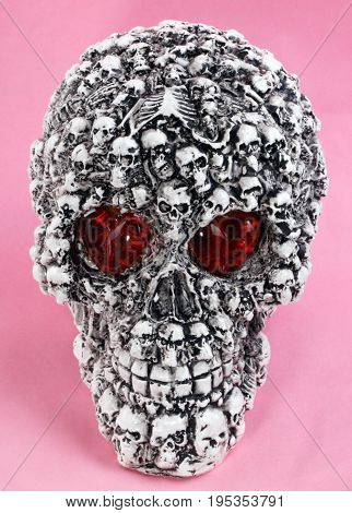image of one skull head toy on pink background