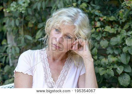 Despondent Middle-aged Woman Sitting Thinking