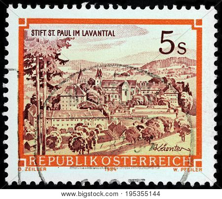 LUGA RUSSIA - APRIL 26 2017: A stamp printed by AUSTRIA shows beautiful view of Saint Paul Abbey in Lavanttal - a Benedictine monastery established in 1091 circa1984
