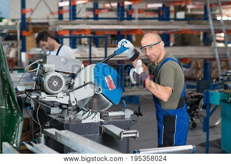 worker in factory on the machine with thumb up