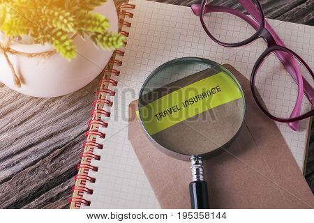 Business Concept : Travel Insurance Written On Envelope With Wooden Background.