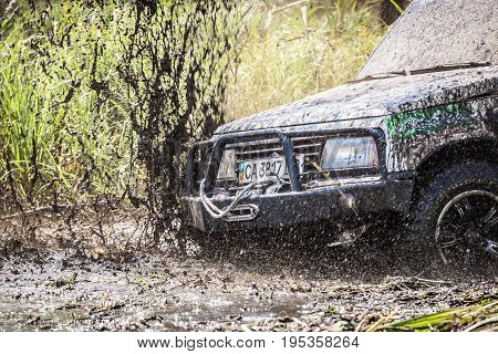 Closeup Of Dirty Off-road Car With Splashes Of Mud.