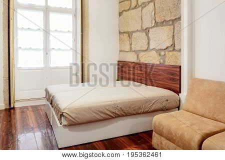 Bedroom Suite with Hardwood Floors and Granit Wall