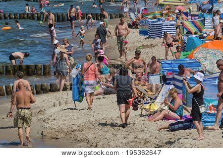 USTRONIE MORSKIE, WEST POMERANIAN / POLAND: Holiday day on the Baltic Sea beach