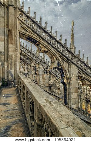 Old photo with architectonic details from the famous Milan Cathedral Lombardy Italy. Vintage processing.