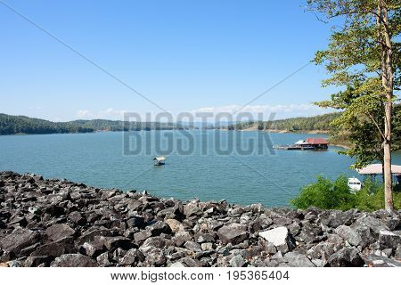 Uttaradit Thailand- December 14 2016: The scenery of Queen Sirikit Dam in Uttaradit Province Thailand with a boathouse is at the lake.